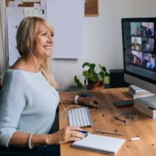 Smiling,Mature,Woman,Having,Video,Call,Via,Computer,In,The